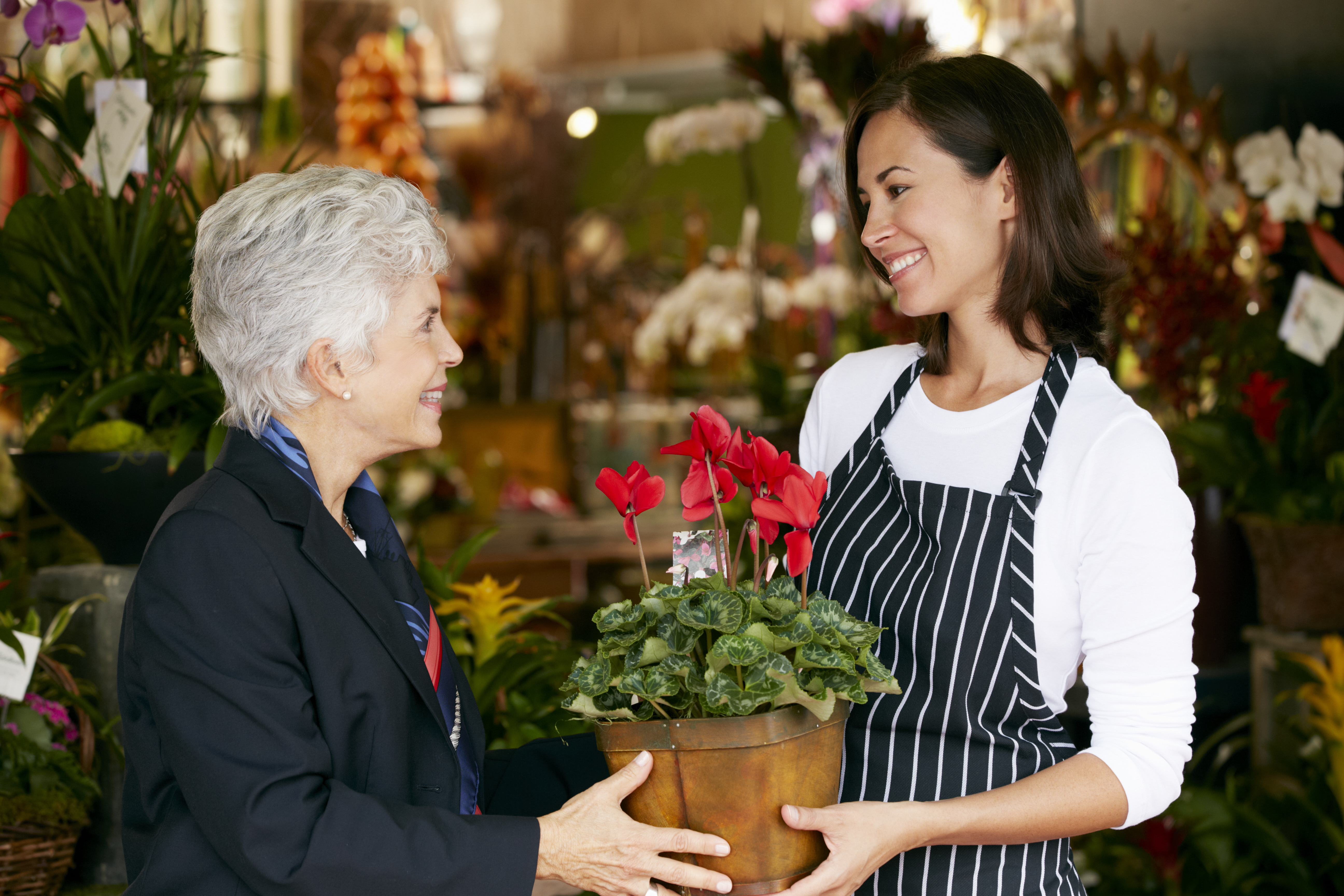 Worker giving personal customer service to client