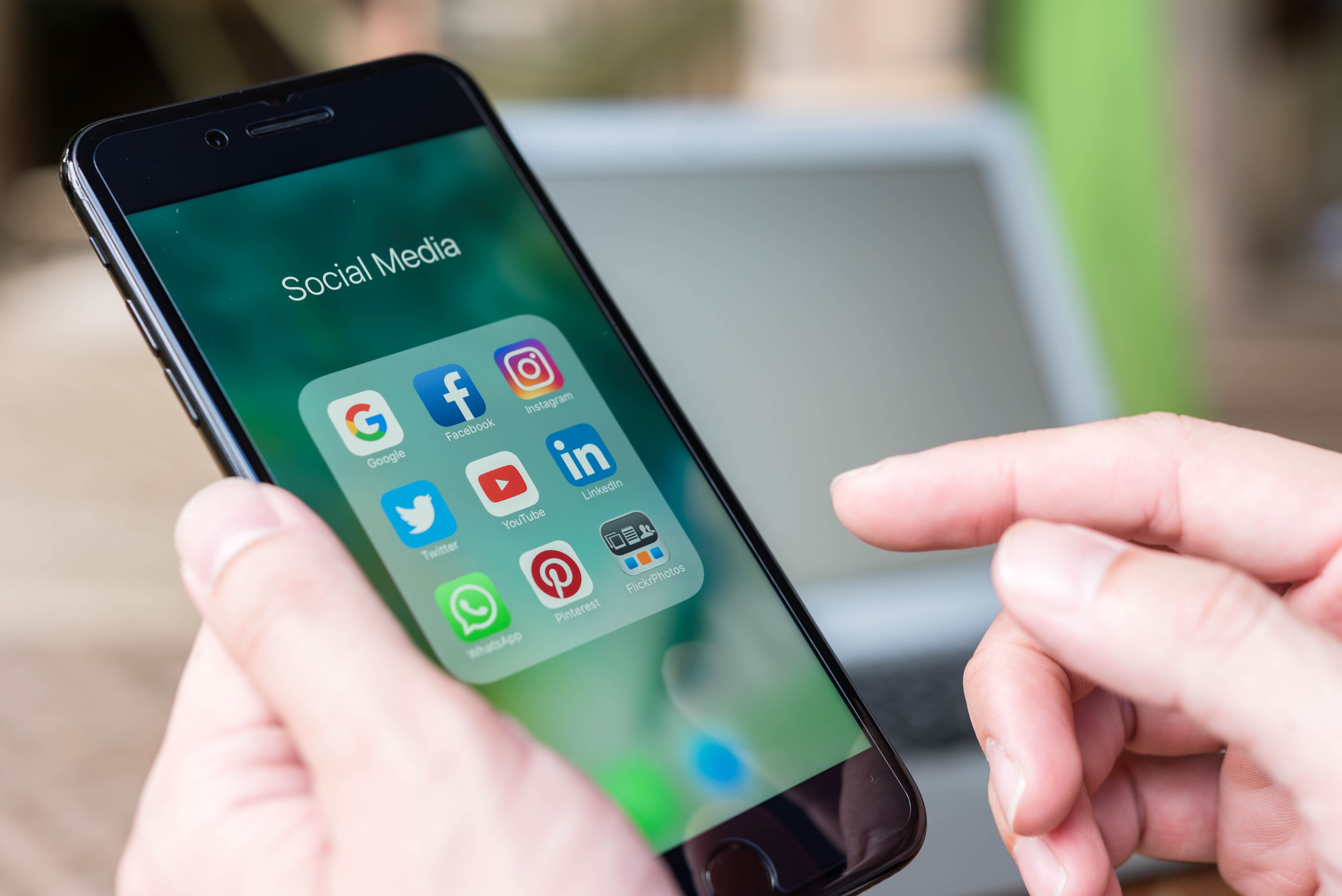 Person reviewing social media channels on phone
